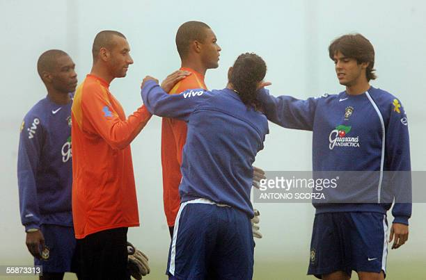 Brazilian goalkeeper Dida is congratulated by teammates Juan Gomes Ronaldinho Gaucho and Kaka on his birthday 07 October 2005 before a training...