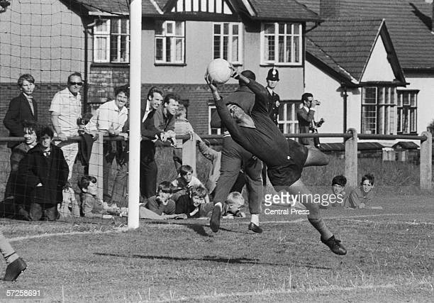 Brazilian goalkeeper Manga makes a save while training at Lymm Grammar School Cheshire during the 1966 World Cup in England July 1966