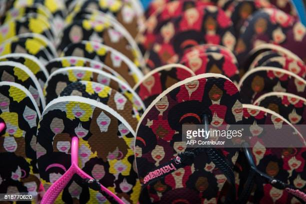 Brazilian Havaianas flipflops are displayed at a store in Sao Paulo Brazil on July 18 2017 The Havaianas ambassadors of Brazil in the world were the...