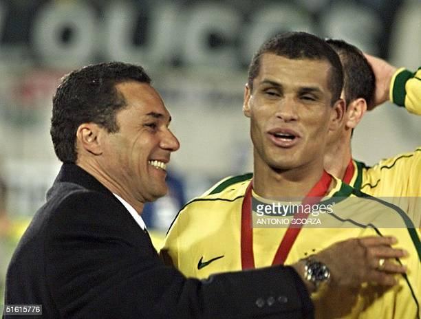 Brazilian head coach Wanderley Luxemburgo hugs forward Rivaldo who scored two goals 18 July in Asuncion Brazil defeated Uruguay 30 for the...