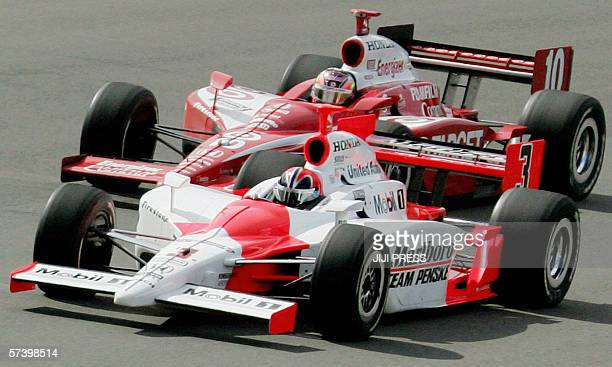 Brazilian Honda driver Helio Castroneves races with twotime defending champion Dan Wheldon of Britain in the Indy Japan 300 at Twin Ring Motegi...