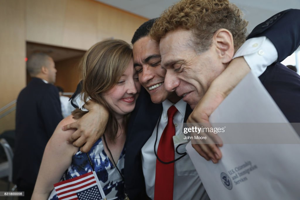 Brazilian immigrant Gleidson Hoffman (C), celebrates after becoming an American citizen at a naturalization ceremony held in the One World Trade Center on August 15, 2017 in New York City. Thirty immigrants took the oath of citizenship to become American citizens at One World Trade, which at 1,776 feet high is the tallest building in the Western Hemishere.