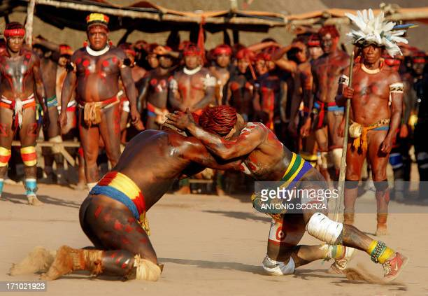 Brazilian Indian warriors of the Yawalapiti and Kuikuro tribes engage in a fight as part of the Kuarup ceremony in an area of the Amazon forest...