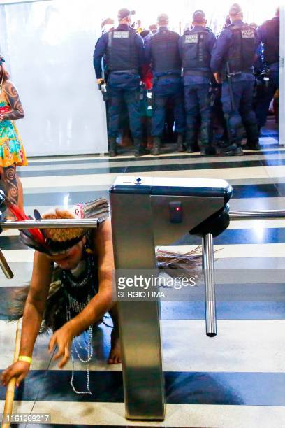 Brazilian indigenous break into the Ministry of Health office during a protest against budget cuts in Brasilia on August 12 2019 Indigenous women...