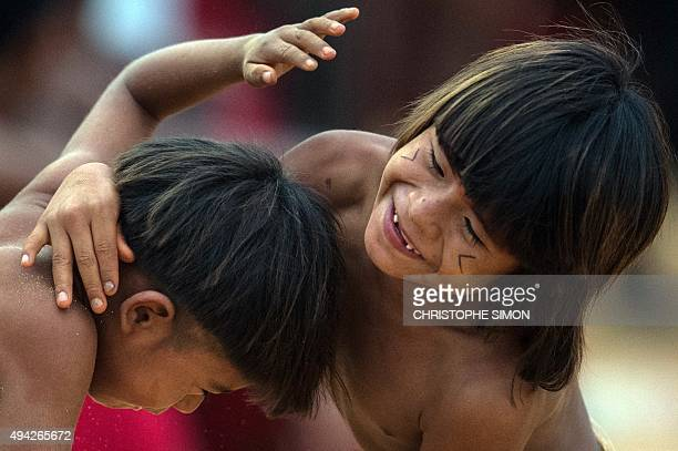 Brazilian indigenous children play during the first World Indigenous Games in Palmas Tocantins Brazil on October 25 Brazil AFP PHOTO / CHRISTOPHE...
