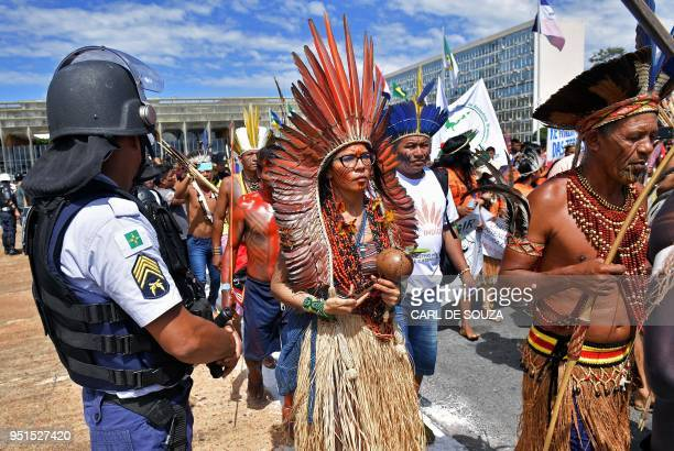 TOPSHOT Brazilian indigenous demonstrators march towards the government's buildings during a protest in Brasilia on April 26 2018 Approximately 2500...