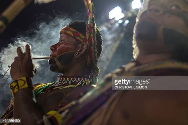 A Brazilian indigenous from the Pataxo tribe smokes his pipe during the first World Indigenous Games in Palmas Tocantins Brazil on October 25 Brazil...