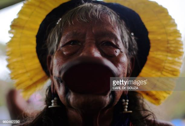 Brazilian indigenous man attends a meeting at the Acampamento Terra Livre in Brasilia on April 23 2018 Approximately 2500 indigenous people from...