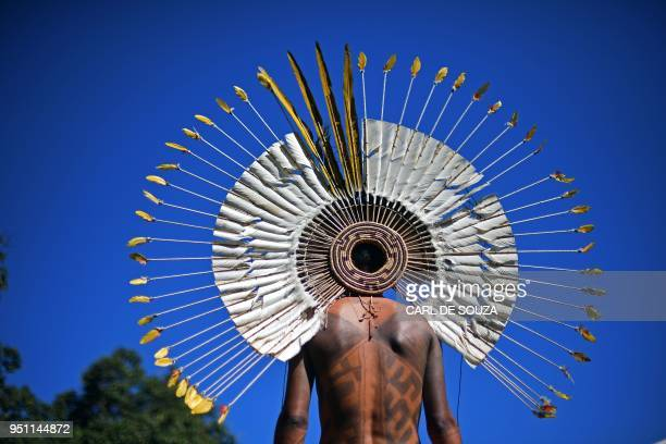 Brazilian indigenous man is pictured at the Acampamento Terra Livre in Brasilia on April 25 2018 Approximately 2500 indigenous people from different...
