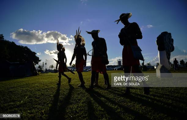 Brazilian indigenous men are pictured at the Acampamento Terra Livre in Brasilia on April 24 2018 Approximately 2500 indigenous people from different...