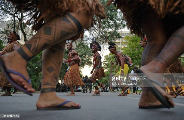 Brazilian indigenous men perform a ritual dance during a protest against the government's decision not to recognize the land demarcation of...