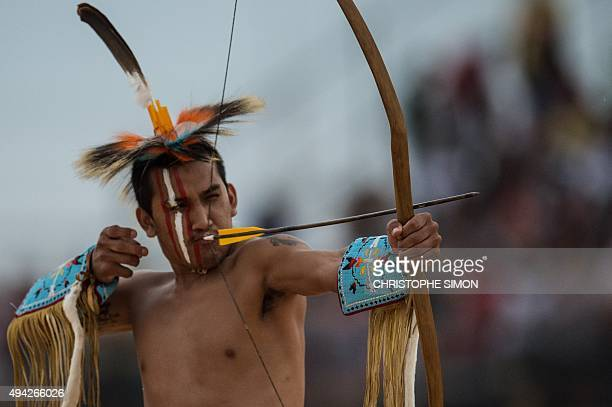 A Brazilian indigenous native participates in the archery competition of the first World Indigenous Games in Palmas Tocantins Brazil on October 25...