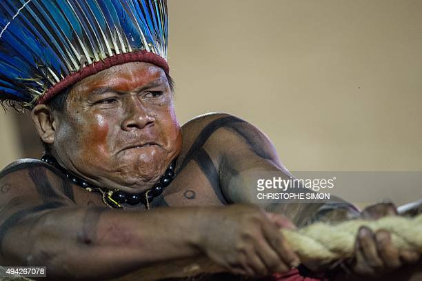 A Brazilian indigenous native participates in the tugofwar competition of the first World Indigenous Games in Palmas Tocantins Brazil on October 25...