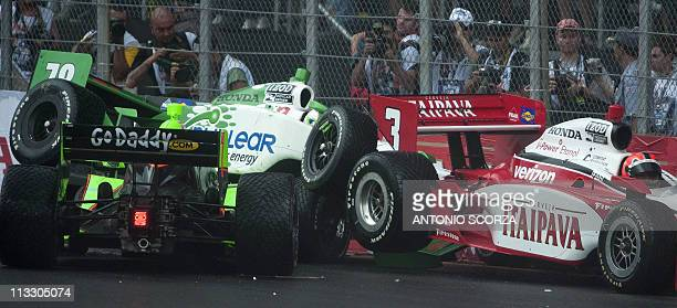 Brazilian IndyCar driver Helio Castro Neves , US Danica Patrick and Swiss Simona de Silvestro crash their cars against the wall at the start of the...