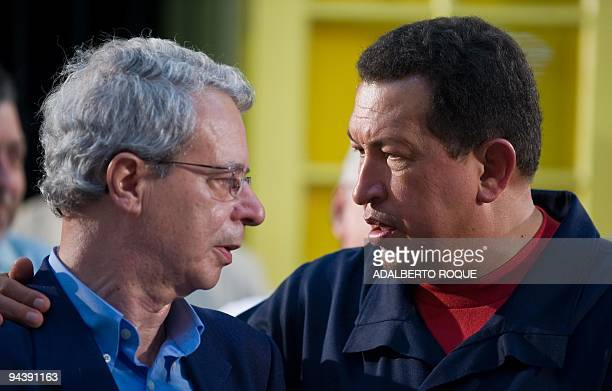 Brazilian intellectual and liberation theologist Frei Betto talks with Venezuelan President Hugo Chavez during a meeting to inaugurate the ALBA house...