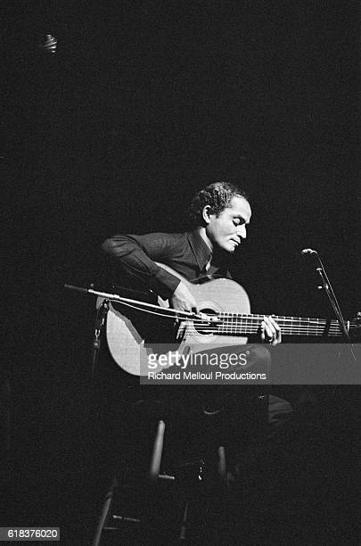 Brazilian jazz guitarist Baden Powell performs on stage in Paris