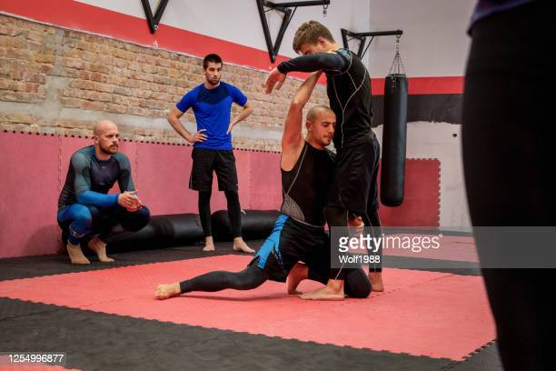 brazilian jiu jitsu bjj private class professor stock photo - martial arts stock pictures, royalty-free photos & images