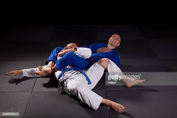 brazilian jiu-jitsu martial arts - chokehold stock pictures, royalty-free photos & images