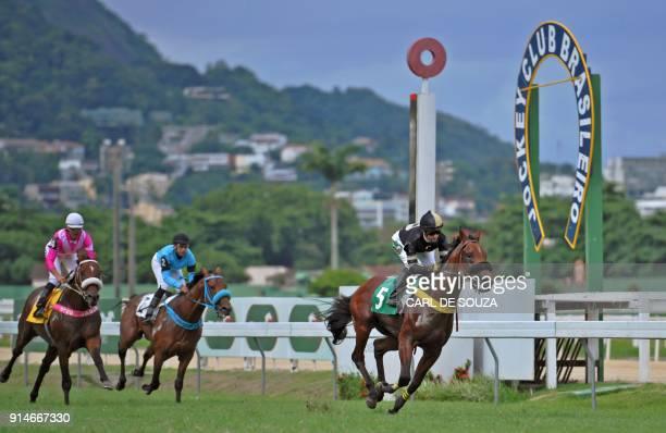 Brazilian jockey Jorge Ricardo crosses the finish line to win at Rio de Janeiro's Hipodromo race track in Rio de Janeiro Brazil on February 4 2018...