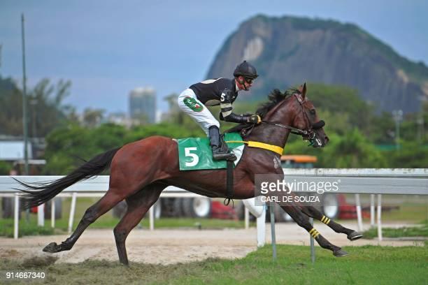TOPSHOT Brazilian jockey Jorge Ricardo crosses the finish line to win at Rio de Janeiro's Hipodromo race track in Rio de Janeiro Brazil on February 4...