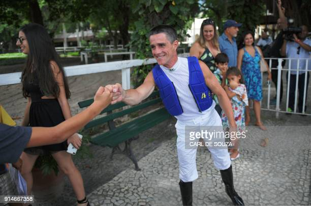 Brazilian jockey Jorge Ricardo greets wellwishers at Rio de Janeiro's Hipodromo race track in Rio de Janeiro Brazil on February 4 2018 Ricardo rode...