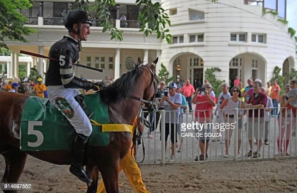 Brazilian jockey Jorge Ricardo smiles after winning at Rio de Janeiro's Hipodromo race track in Rio de Janeiro Brazil on February 4 2018 Ricardo rode...