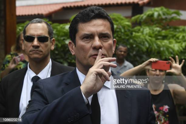 TOPSHOT Brazilian Judge Sergio Moro gestures as he leaves the house of Brazilian Presidentelect Jair Bolsonaro after a meeting in Rio de Janeiro...