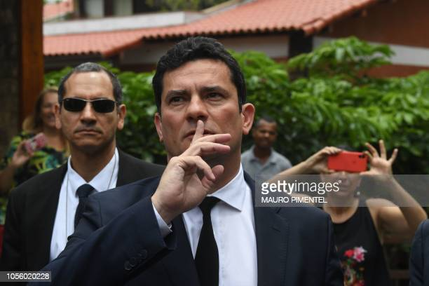 Brazilian Judge Sergio Moro gestures as he leaves the house of Brazilian Presidentelect Jair Bolsonaro after a meeting in Rio de Janeiro Brazil on...