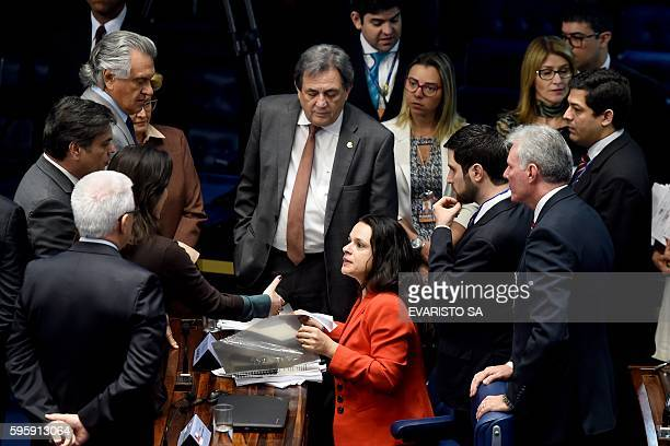 Brazilian jurist Janaina Paschoal coauthor of the complaint against President Dilma Rousseff is rounded by Senators during the second day Senate...