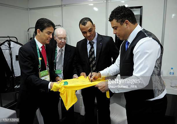 Brazilian legends Bebeto Mario Zagallo Cafu and Ronaldo sign a shirt before the Preliminary Draw of the 2014 FIFA World Cup at Marina Da Gloria on...