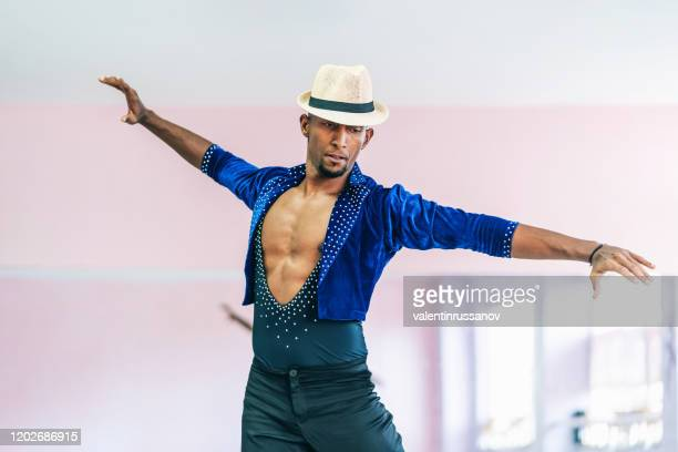 brazilian male dancer with hat and costume practicing in studio - samba stock pictures, royalty-free photos & images