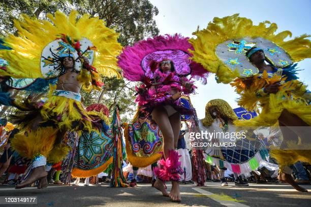Brazilian Maracatu dancers perform during the traditional Galo da Madrugada carnival parade along the streets of Sao Paulo, Brazil, on February 25,...