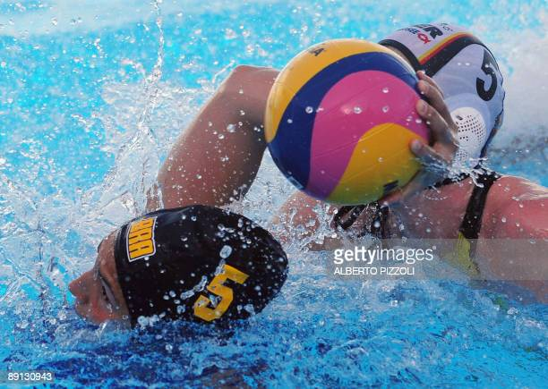 Brazilian Marina Zablith fights for the ball with German captain Katrin Dierolf during the Women's waterpolo preliminary round Group D match Germany...