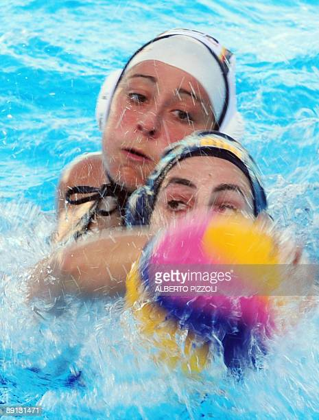 Brazilian Marina Zablith fights for the ball with German Carmen Gelse during the Women's waterpolo preliminary round Group D match Germany vs Brazil...