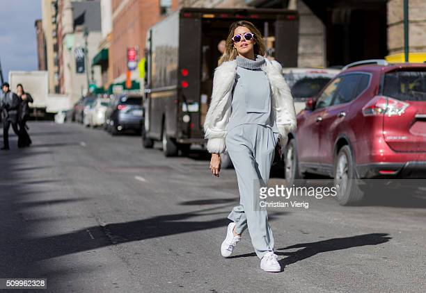 Brazilian Martha Graeff wearing a BCBG Max Azria jumpsuit and a white Loft747 fluffy fur jacket seen outside BCBG Max Azria during New York Fashion...