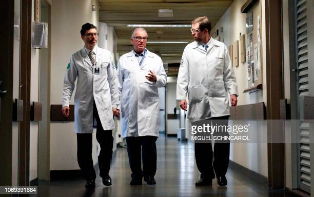 Brazilian medical doctors Wellington Andraus Luiz Carneiro and Dani Ejzenberg responsible for the firstever uterus transplant from a dead donor walk...