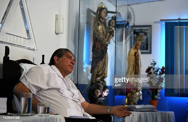 Brazilian medium Joao de Deus gestures whilst attending his patients at his 'Casa de Dom Inacio de Loyola' in Abadiania 120km southwest of Brasilia...