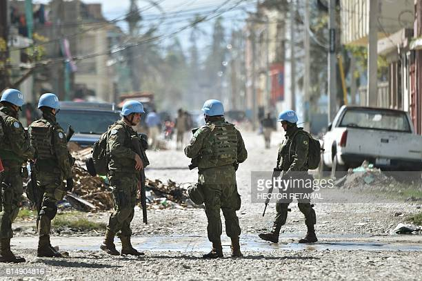 Brazilian members of the United Nations Stabilization Mission In Haiti secure a perimeter before arrival of UN Secretary-General Ban Ki-moon at a...