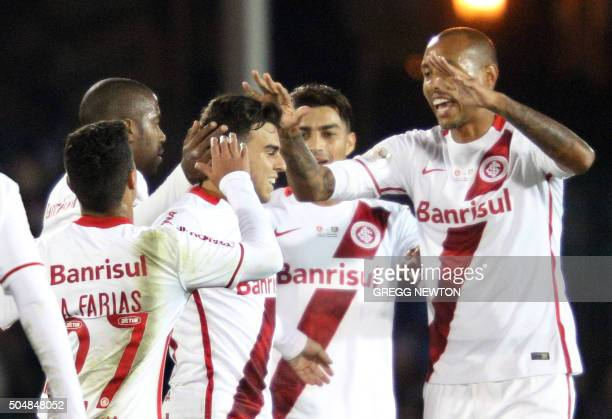 Brazilian midfielder Andrigo of Internacional is congratulated by teammates after scoring a goal during the second half of their Florida Cup game...