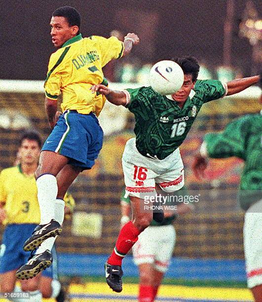 Brazilian midfielder Djalminha and Mexico midfielder Alberto Coyote jump for the ball in first half action of their friendly game 30 April at the...