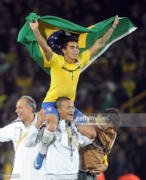 Brazilian midfielder Dudu celebrates with his national flag after Brazil's victory in the FIFA 2011 Under20 World Cup final match against Portugal in...