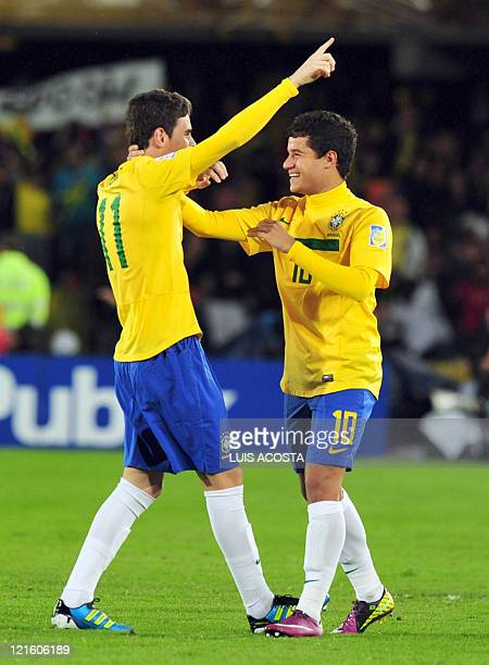 Brazilian midfielder Oscar celebrates with teammate Philippe Coutinho after scoring against Portugal during the FIFA 2011 Under20 World Cup final...