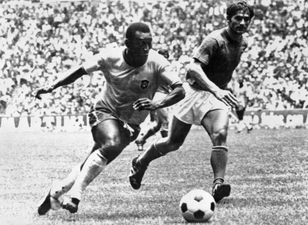 Brazilian midfielder Pelé dribbles past Italian defender Tarcisio Burgnich during the World Cup final on 21 June 1970 in Mexico City. Pelé scored the...