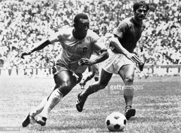 Brazilian midfielder Pelé dribbles past Italian defender Tarcisio Burgnich during the World Cup final on 21 June 1970 in Mexico City Pelé scored the...
