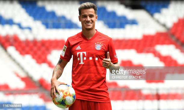 TOPSHOT Brazilian midfielder Philippe Coutinho the new recruit of German first division Bundesliga football club FC Bayern Munich poses during his...
