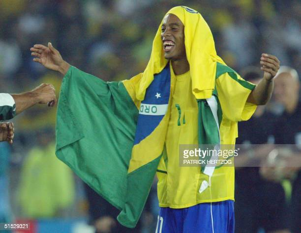 Brazilian midfielder Ronaldinho celebrates the victory of his team, 30 June 2002 in Yokohama, Japan, after the final of the 2002 FIFA World Cup...