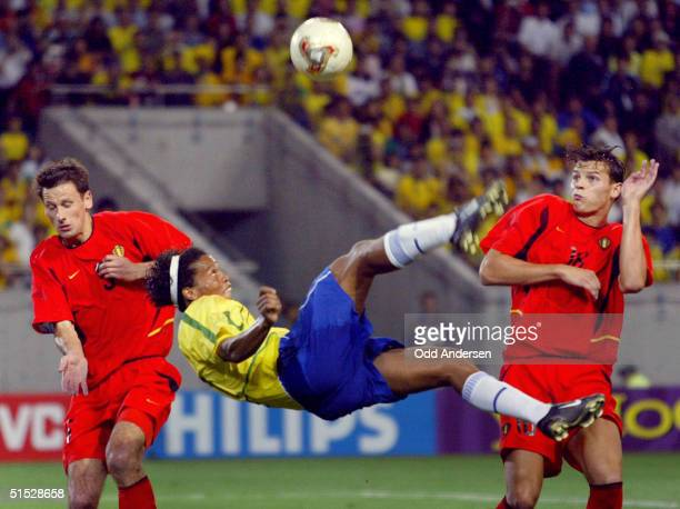 Brazilian midfielder Ronaldinho jumps for a high kick during the Brazil/Belgium second round match of the FIFA 2002 Soccer World Cup 17 June 2002 at...