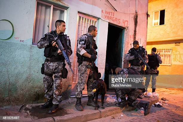 Brazilian military police officers find drugs after entering the unpacified Complexo da Mare, one of the largest 'favela' complexes in Rio, on March...