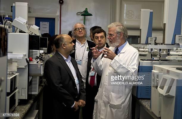 Brazilian Minister of Sports George Hilton listens to Professor Francisco Radler coordinator of the Brazilian Doping Control Laboratory of the...
