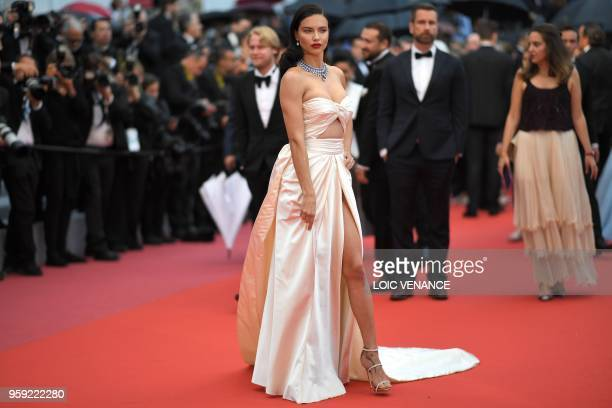 Brazilian model Adriana Lima poses as she arrives on May 16 2018 for the screening of the film 'Burning' at the 71st edition of the Cannes Film...